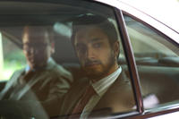 Kiefer Sutherland as Jim Cross and Riz Ahmed as Changez Khan in
