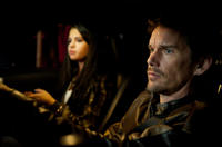 Selena Gomez as Kid and Ethan Hawke as Brent Magna in