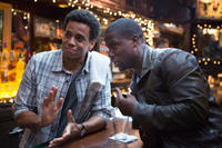 Michael Ealy as Danny and Kevin Hart as Bernie in