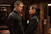 Channing Tatum as Caine Wise and Mila Kunis as Jupiter Jones in