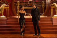Mila Kunis as Jupiter Jones and Douglas Booth as Titus Abrasax in
