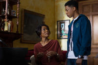 Angela Bassett as Aretha and Jacob Latimore as Langston in