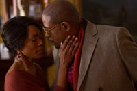 Angela Bassett as Aretha and Forest Whitaker as Reverend Cornell Cobbs in
