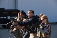 Joe Manganiello as Grinder, Arnold Schwarzenegger as Breacher and Mireille Enos as Lizzy in