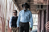 Cillian Murphy as Agent Buchanan and Morgan Freeman as Joseph Tagger in