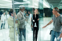 Cillian Murphy, Morgan Freeman, Rebecca Hall and director Wally Pfister on the set of