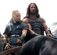 Aksel Hennie as Tydeus and Dwayne Johnson as Hercules in