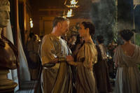 Jared Harris as Severus and Carrie-Anne Moss as Aurelia in