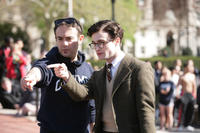Director John Krokidas and Daniel Radcliffe on the set of