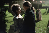 Gugu Mbatha-Raw as Dido Elizabeth Belle and Sam Reid as John Davinier in