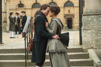 Sam Reid as John Davinier and Gugu Mbatha-Raw as Dido Elizabeth Belle in