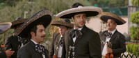 Omar Chaparro as Canicas and Jaime Camil as Alejandro in