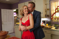 Maria Bello as Cheryl White and Kevin Costner as Jim White in