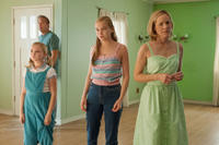 Kevin Costner as Jim White, Elsie Fisher as Jamie White, Morgan Saylor as Julie White and Maria Bello as Cheryl White in