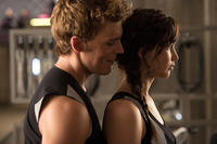 Sam Claflin as Finnick Odair and Jennifer Lawrence as Katniss Everdeen in