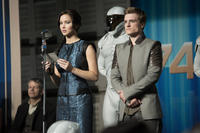 Jennifer Lawrence as Katniss Everdeen and Josh Hutcherson as Peeta Mellark in