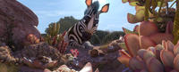 Khumba voiced by Jake T. Austin in