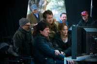 Producer John DeLuca, director Rob Marshall, James Corden and Emily Blunt on the set of