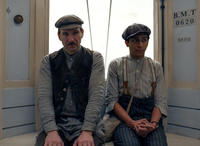 Ralph Fiennes as M. Gustave and Tony Revolori as Zero Moustafa in