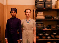 Tony Revolori as Zero and Saoirse Ronan as Agatha in