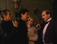 Willem Dafoe as Jopling, Adrien Brody as Dmitri, Mathieu Almaric as Serge and Ralph Fiennes as M. Gustave in