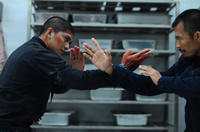 Iko Uwais as Rama and Cecep Arif Rahman as The Assassin in