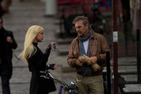 Amber Heard and Kevin Costner in