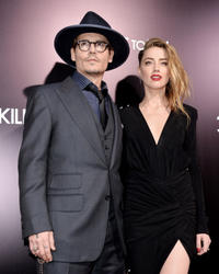 Johnny Depp and Amber Heard at the California premiere of
