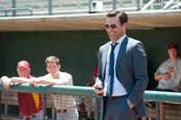 Jon Hamm as JB Bernstein in