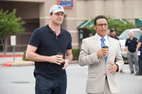 Jon Hamm as JB Bernstein and Aasif Mandvi as Ash in