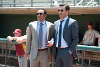 Aasif Mandvi as Ash and Jon Hamm as JB Bernstein in