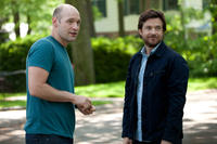 Corey Stoll as Paul Altman and Jason Bateman as Judd Altman in