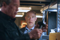 Arnold Schwarzenegger as Terminator and JK Simmons as detective O'Brien in