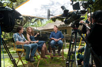 Luke Bracey, Liana Liberto and writer Nicholas Sparks on the set of