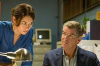 Olga Kurylenko as Alice Fournier and Pierce Brosnan as Peter Devereaux in