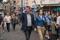 Pierce Brosnan as Peter Devereaux and Olga Kurylenko as Alice Fournier in