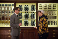 Colin Firth as Harry Hart and Taron Egerton as Eggsy in