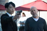 Rain as Mark and Bruce Willis as Omar in