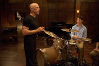 J.K. Simmons as Fletcher and Miles Teller as Andrew in