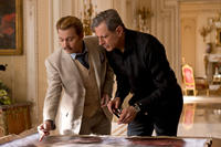 Johnny Depp as Charlie Mortdecai and Jeff Goldblum as Krampf in