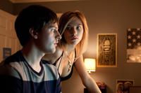 Travis Tope as Chris Truby and Olivia Crocicchia as Hannah Clint in
