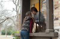 Kaitlyn Dever as Brandy Beltmeyer and Ansel Elgort as Tim Mooney in