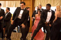 Josh Gad as Doug Harris and Kevin Hart as Jimmy Callahan in