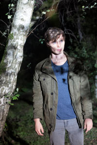 "Tyler Johnston as Kris in the horror film ""FEED THE GODS"" an XLrator Media release."
