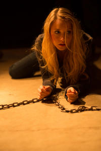 "Emily Tennant as Brit in the horror film ""FEED THE GODS"" an XLrator Media release."