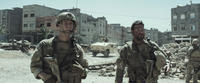 Jake Mcdorman as Biggles and Bradley Cooper as Chris Kyle in