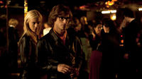 Aymeline Valade as Betty Catroux and Gaspard Ulliel as Yves Saint Laurent in