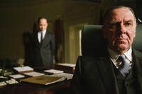 Giovanni Ribisi as Lee White and Tom Wilkinson as President Lyndon B. Johnson in