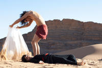 "Reece Ritchie as Afshin and Frieda Pinto as Elaheh in ""Desert Dancer."""