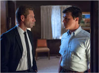 Finn Wittrock as Freddie Steinmark and Aaron Eckhart as Darrell Royal in